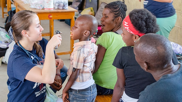 Doctor examining a small boy. Part of a medical mission in Haiti.