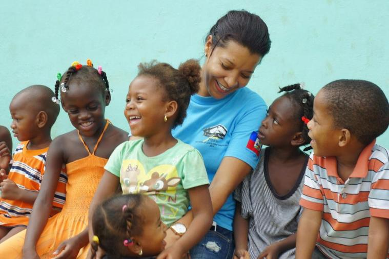 Cici Lugo sitting with children